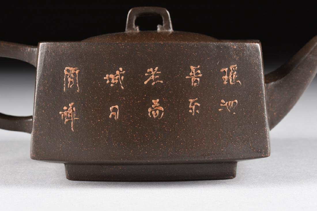 A CHINESE RED STONEWARE TEAPOT, YIXING PROVINCE, LATE - 7