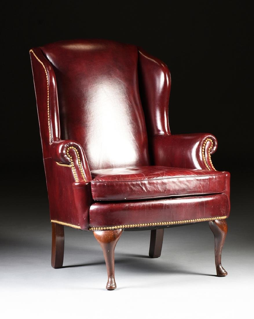 A HANCOCK & MOORE LEATHER UPHOLSTERED MAHOGANY WING