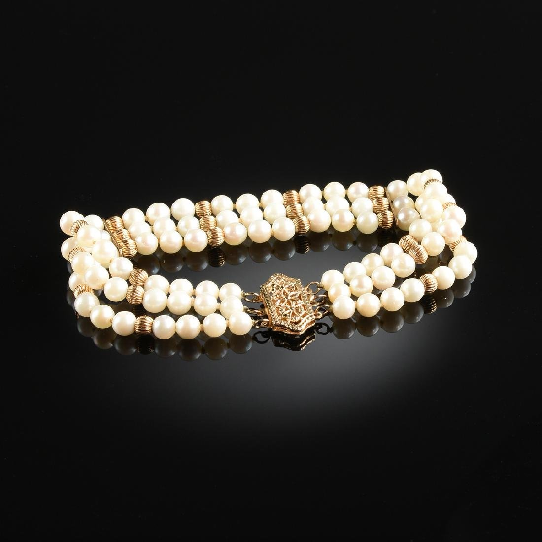 A 14K YELLOW GOLD AND PEARL LADY'S BRACELET,