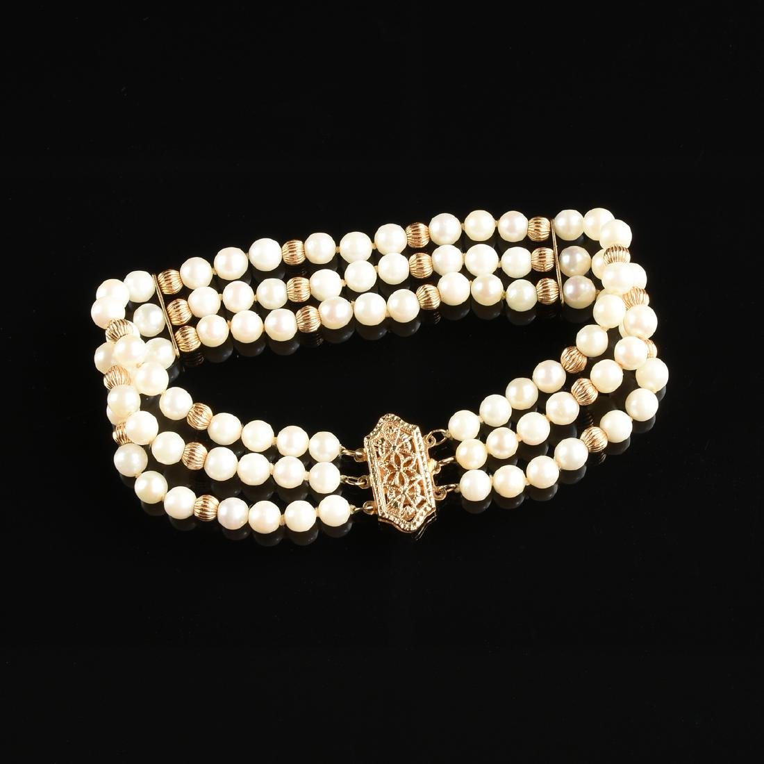 A 14K YELLOW GOLD AND PEARL LADY'S BRACELET, - 2