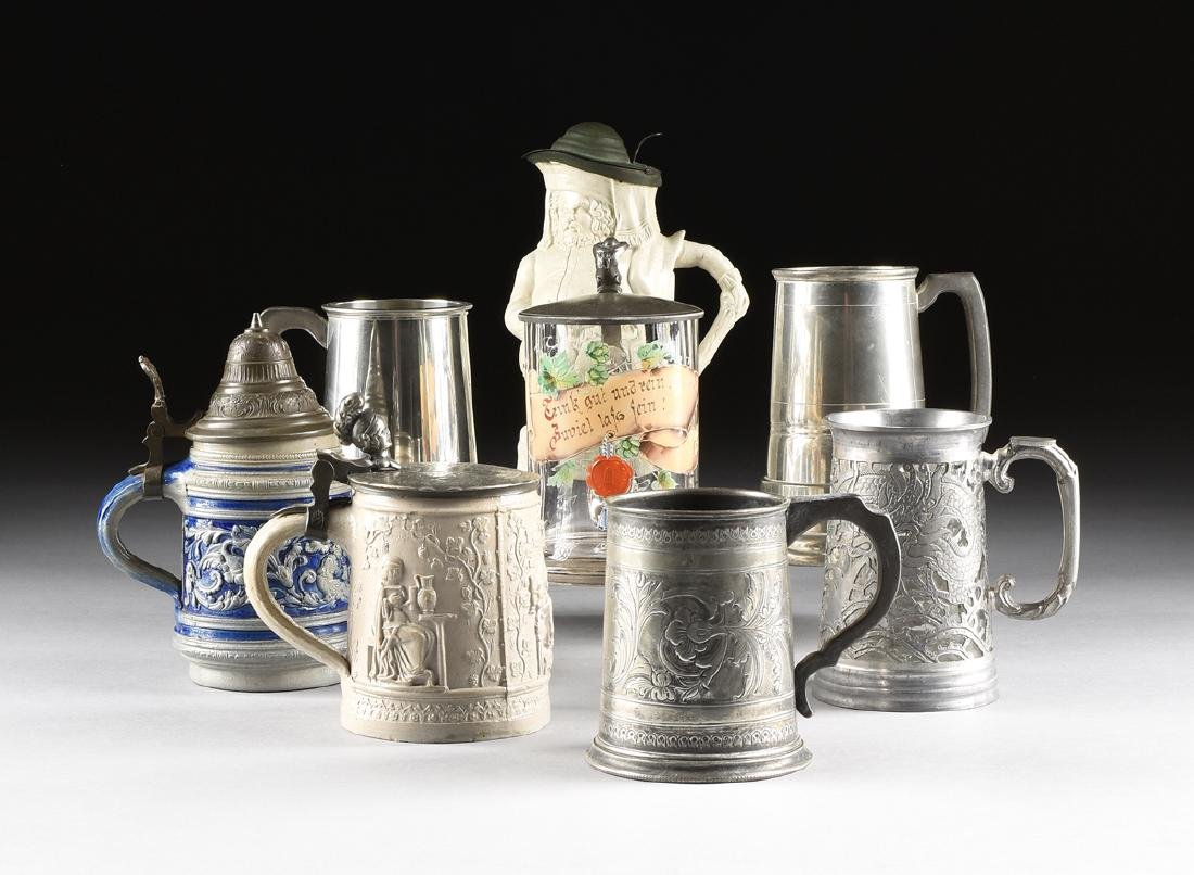 A GROUP OF EIGHT MUGS AND TANKARDS,