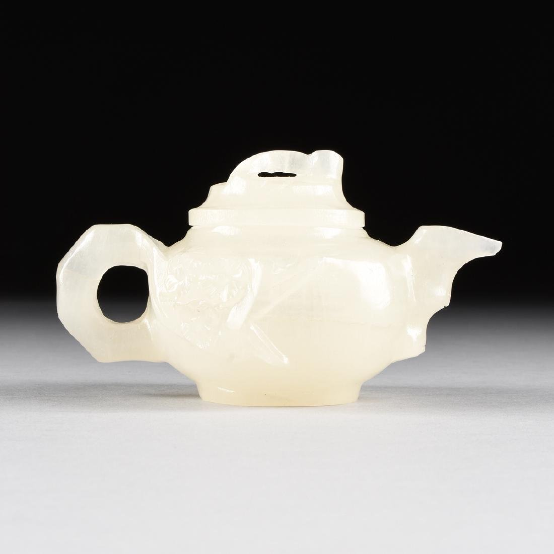 A CHINESE CARVED WHITE MUTTON FAT JADE TEAPOT WITH - 2