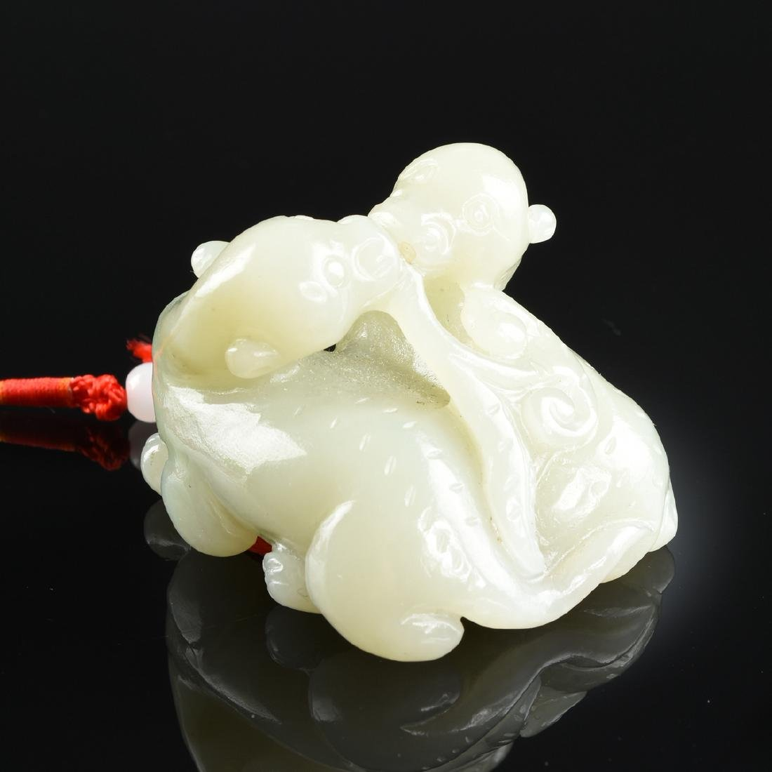 A CHINESE CARVED JADE FIGURAL PENDANT, 20TH CENTURY, - 3