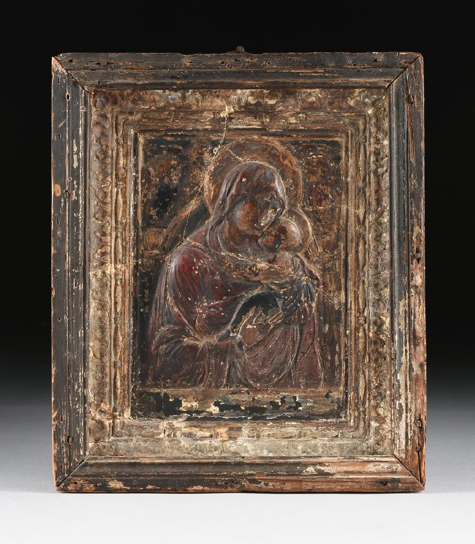 A GREEK RELIEF CARVED PARCEL GILT POLYCHROME GESSO AND