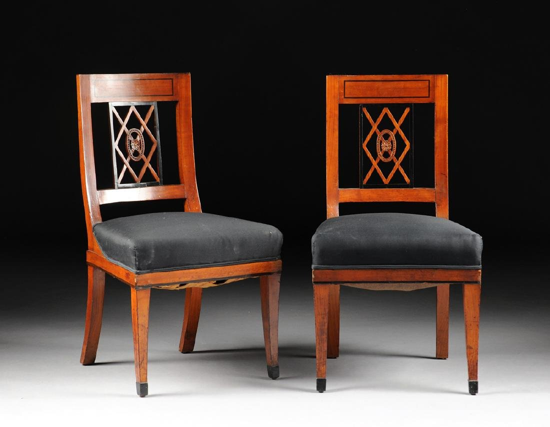 A PAIR OF BIEDERMEIER CARVED AND EBONIZED FRUITWOOD