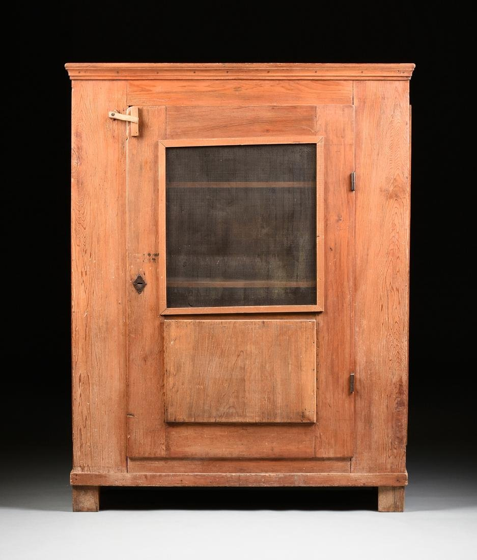 AN AMERICAN PRIMITIVE CARVED PINE PIE SAFE CABINET,