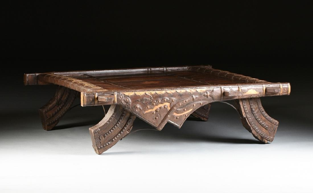 AN INDIAN BRASS AND WROUGHT IRON MOUNTED CARVED WOOD