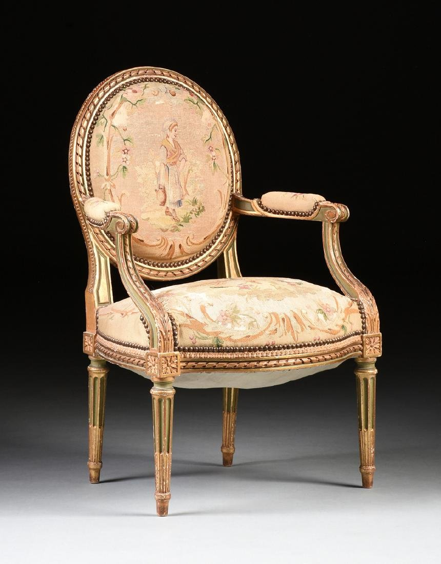 A FRENCH LOUIS XVI STYLE PAINTED AND GILT CARVED OAK