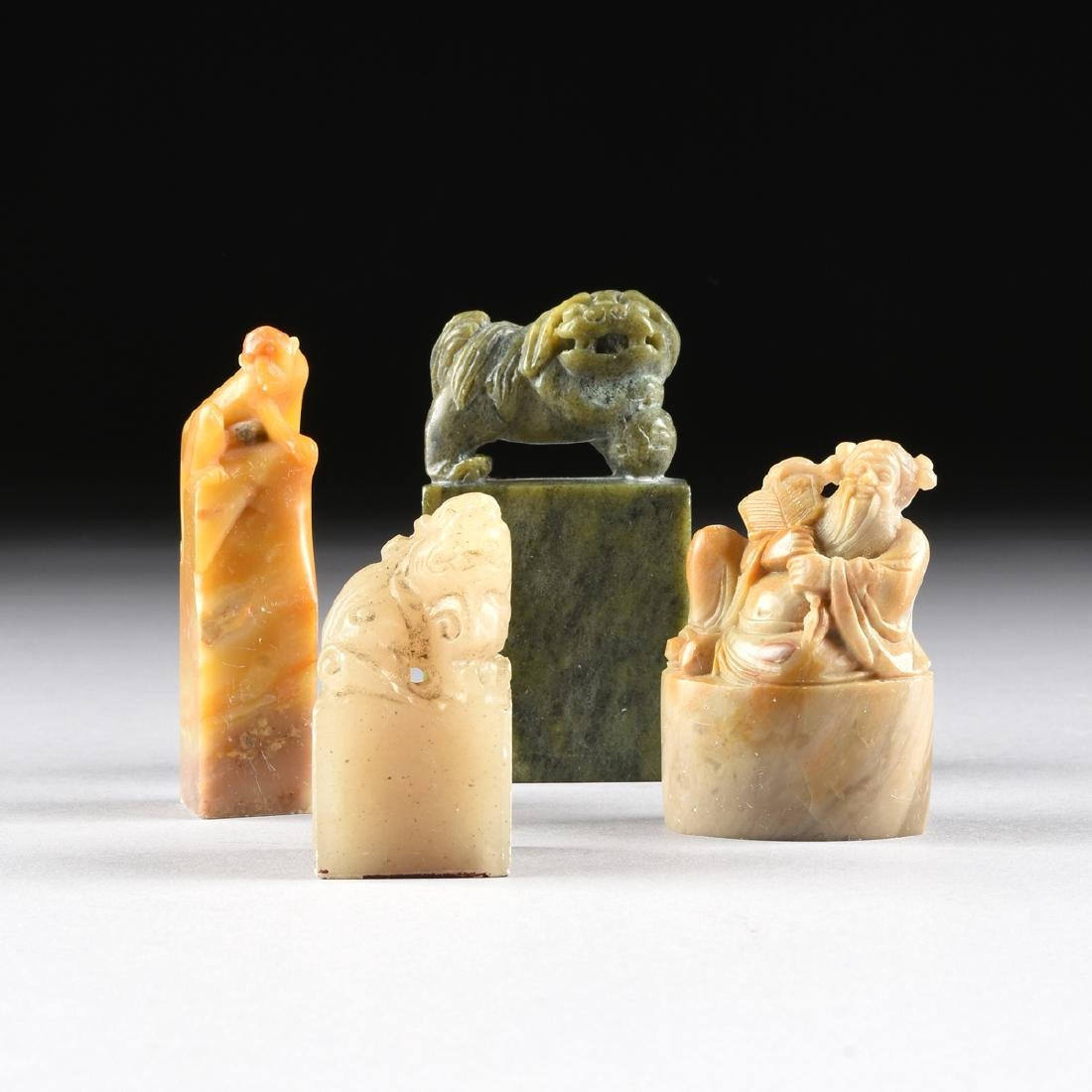 A GROUP OF FOUR SOAPSTONE FIGURAL SEALS,