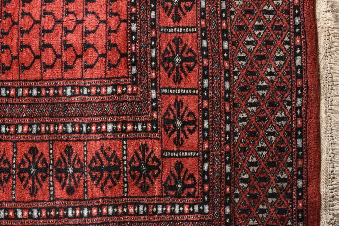 A SEMI ANTIQUE HAND WOVEN WOOL TEKKE BOKHARA RUG, CIRCA - 4
