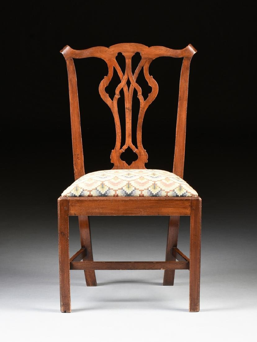 A COLONIAL GOTHIC CHIPPENDALE STYLE CARVED CHERRY SIDE