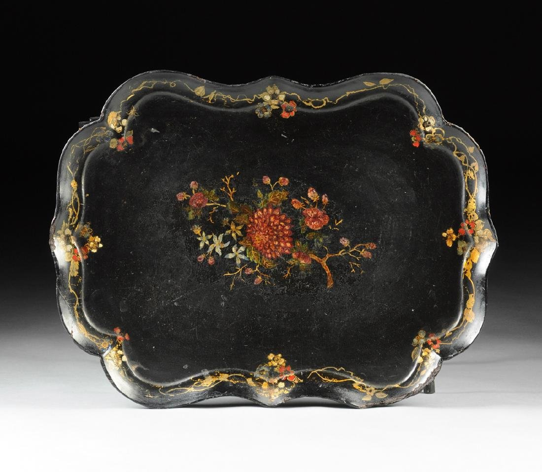 A VICTORIAN PARCEL GILT AND POLYCHROME PAINTED BLACK