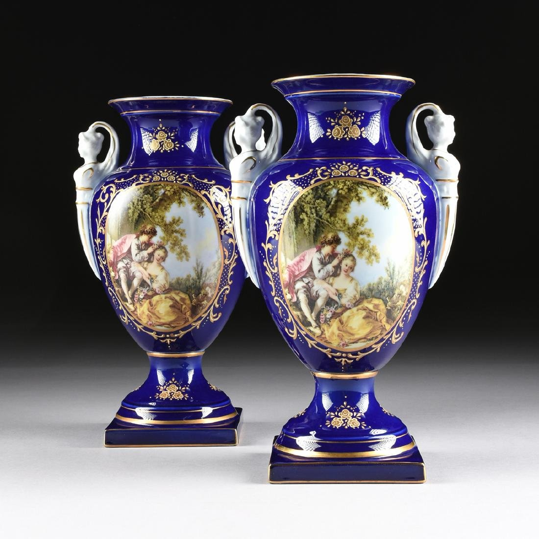 A PAIR OF NEOCLASSICAL STYLE LIMOGES PORCELAIN VASES