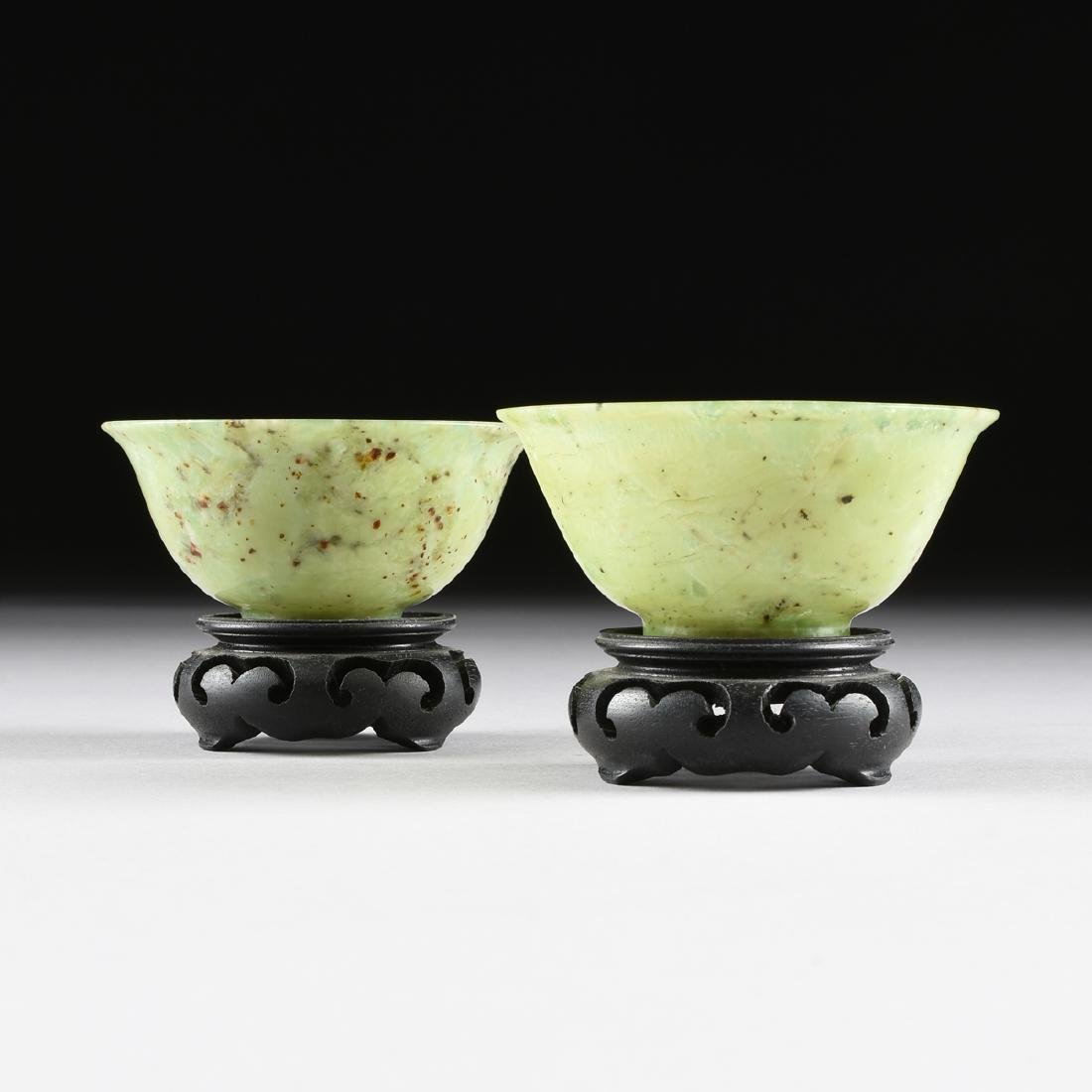A PAIR OF CHINESE TRANSLUCENT MOTTLED GREEN JADE BOWLS,