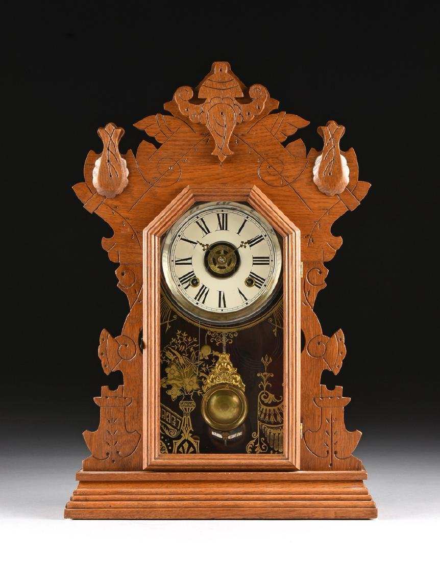 AN ANSONIA CLOCK COMPANY EIGHT DAY CARVED OAK MANTLE