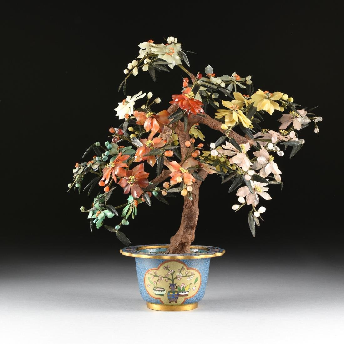 A CHINESE HARD STONE BOTANICAL STUDY IN A CLOISONNE
