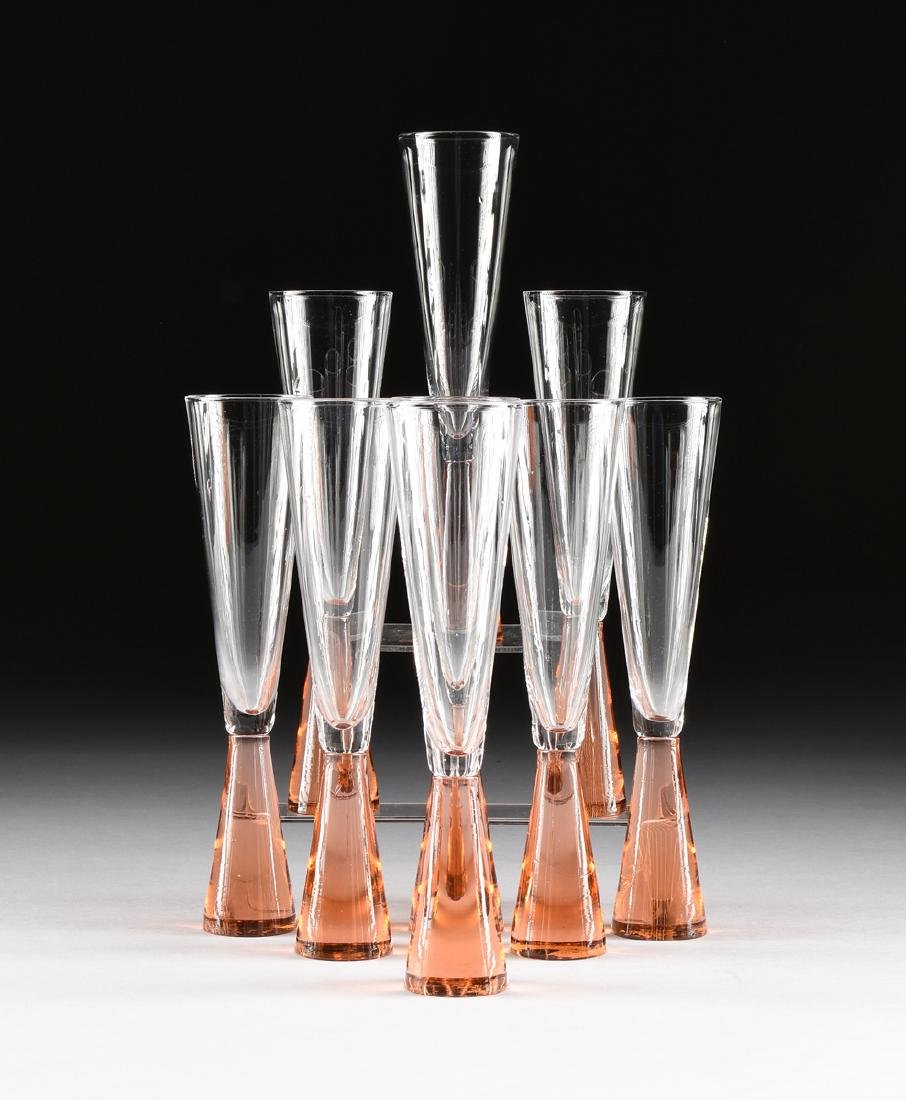 A SET OF NINE CAST AND BLOWN CHAMPAGNE FLUTES, PROBABLY