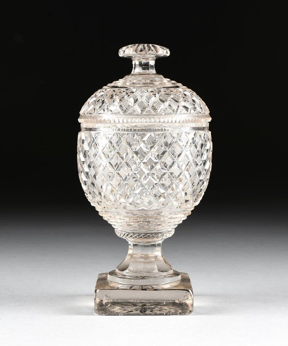 AN ANGLO-IRISH PRESSED CLEAR CRYSTAL SUGAR URN WITH