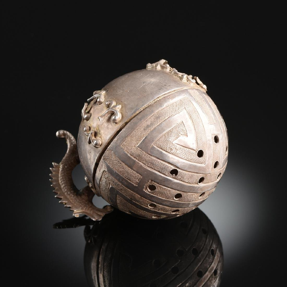 A CHINESE EXPORT SILVER DRAGON HANDLED TEA BALL, EARLY