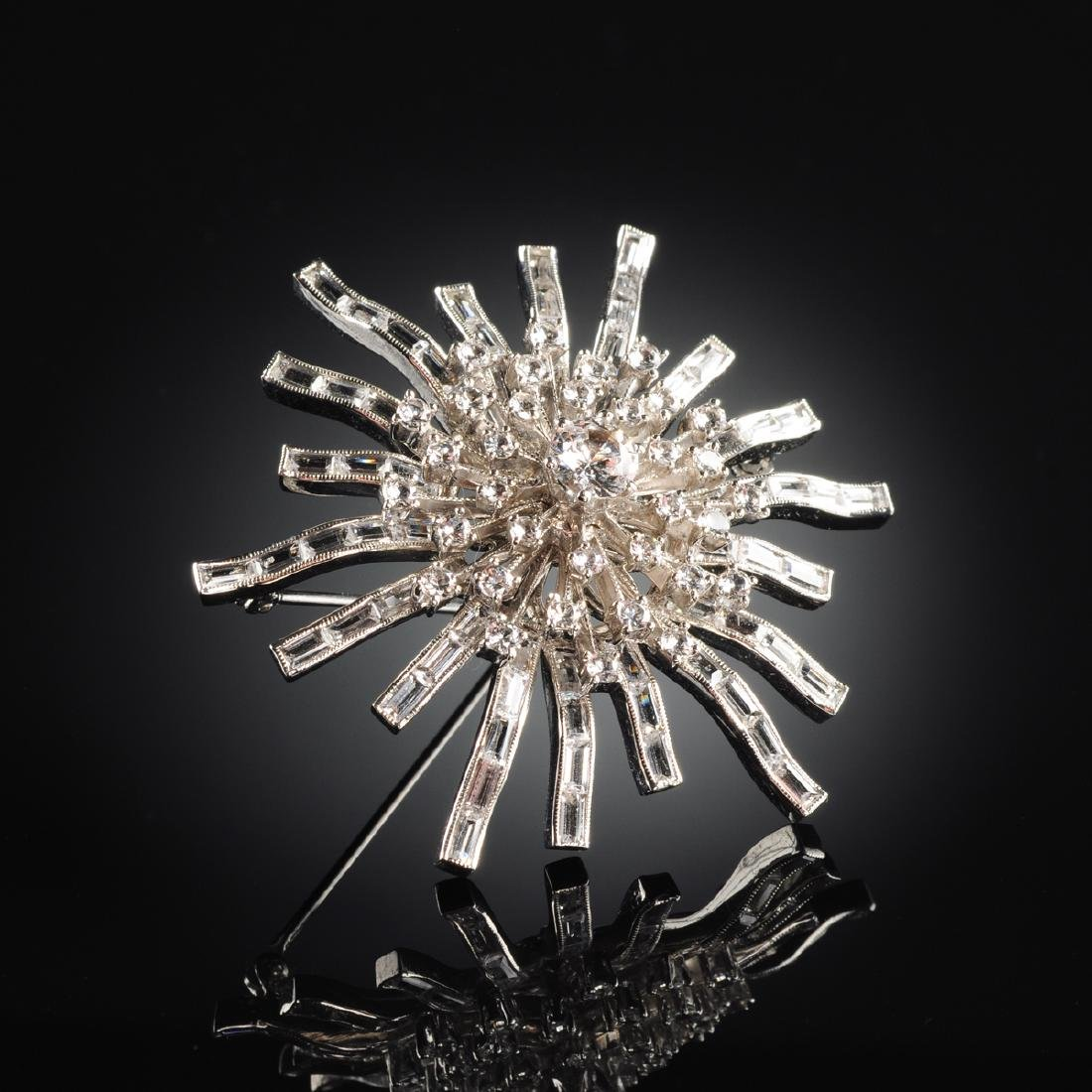 A STERLING SILVER LADY'S STAR FORM PIN/BROOCH,