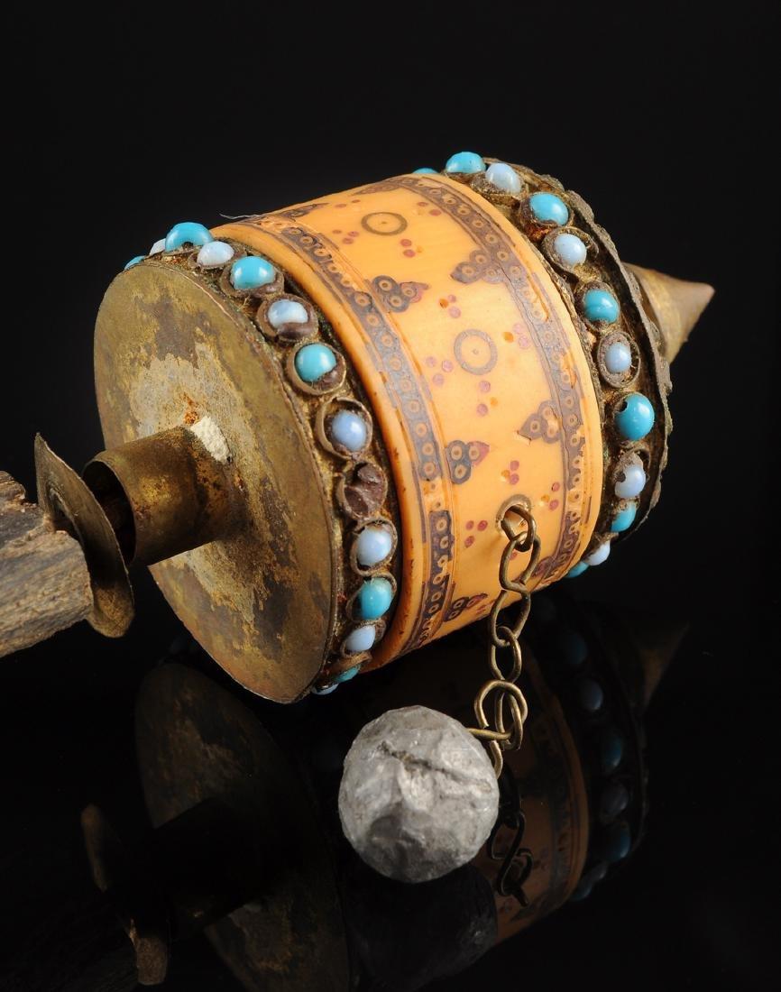 A TIBETAN BLUE GLASS BEAD MOUNTED GILT TIN AND CARVED - 2