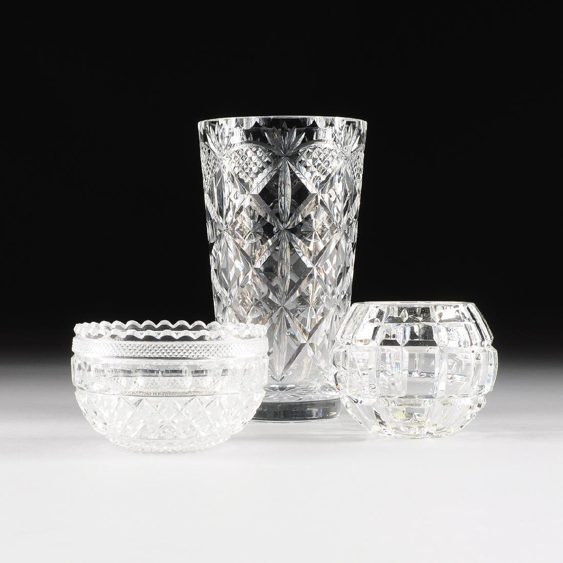 A GROUP OF THREE VARIOUS CUT AND MOLDED GLASS TABLE