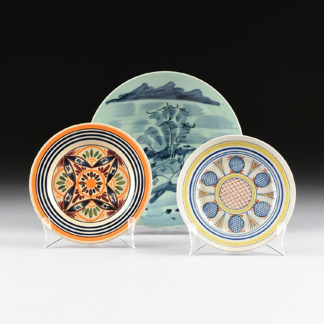 A GROUP OF THREE CERAMIC PLATES,