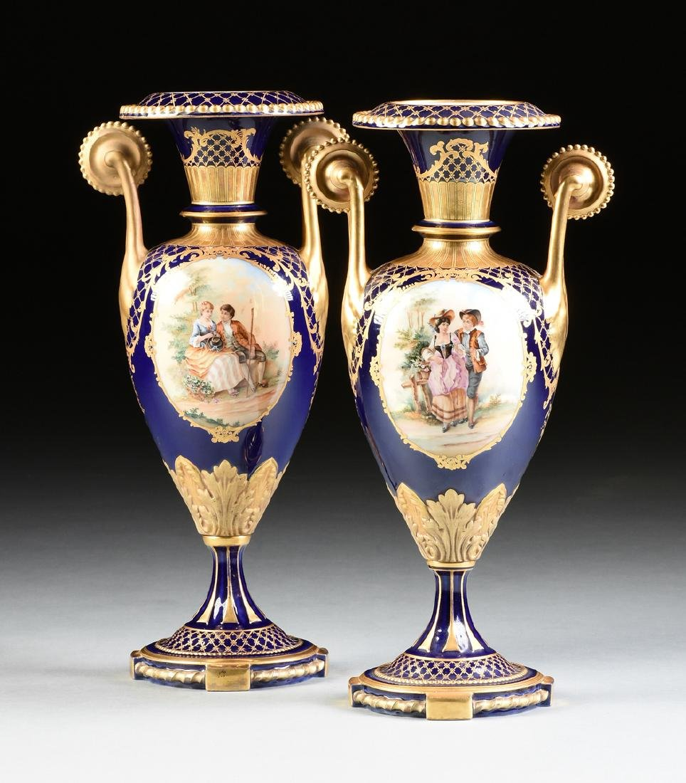 A PAIR OF SÈVRES STYLE PARCEL GILT COBALT BLUE GROUND