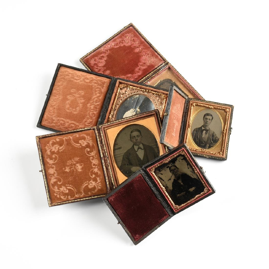 A GROUP OF FIVE EARLY PHOTOGRAPHIC PORTRAITS IN LEATHER