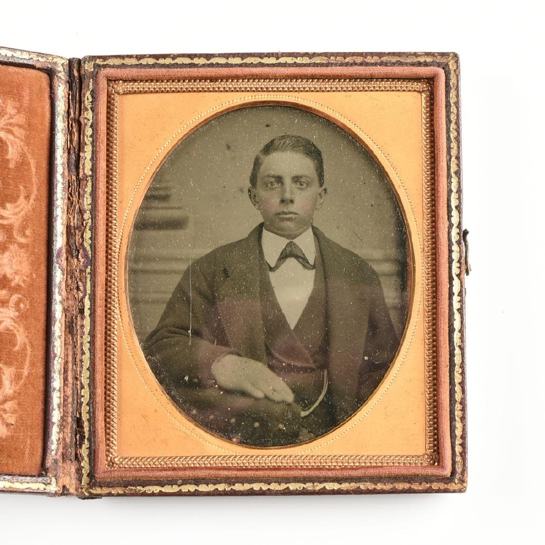 A GROUP OF FIVE EARLY PHOTOGRAPHIC PORTRAITS IN LEATHER - 8