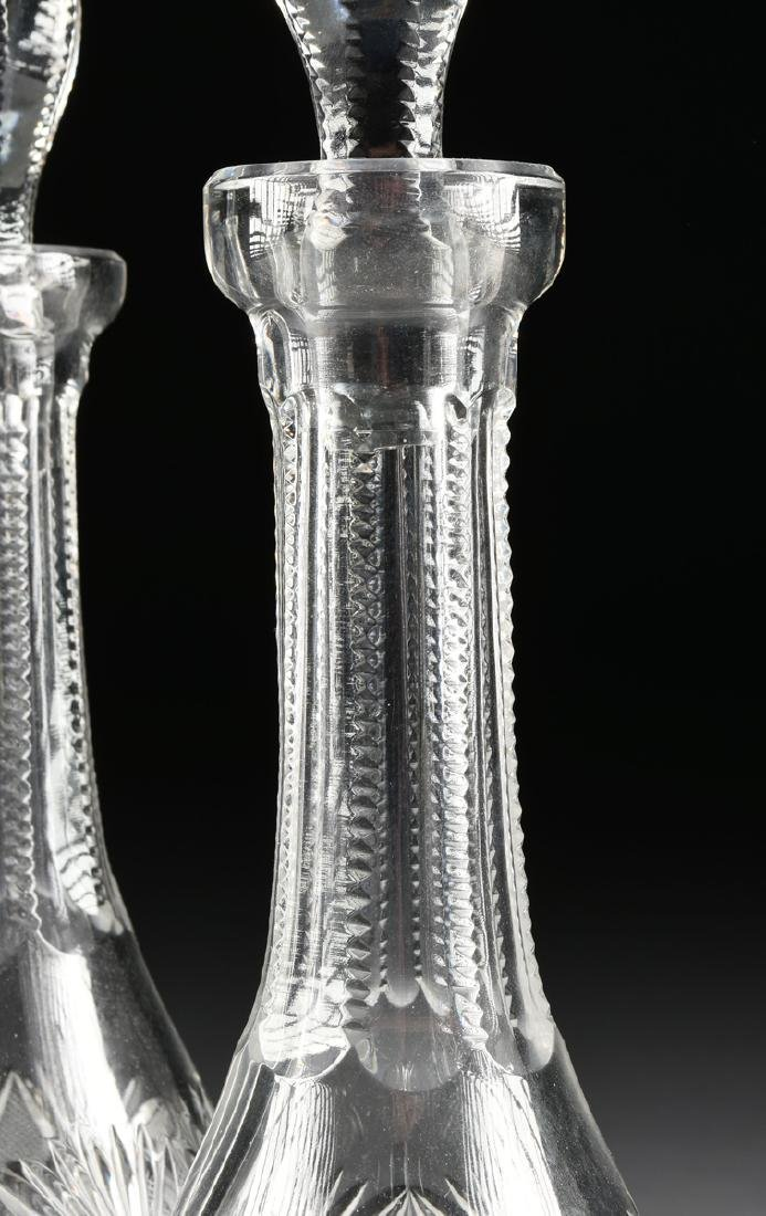 A GROUP OF FOUR CRYSTAL DECANTERS WITH STOPPERS, - 4