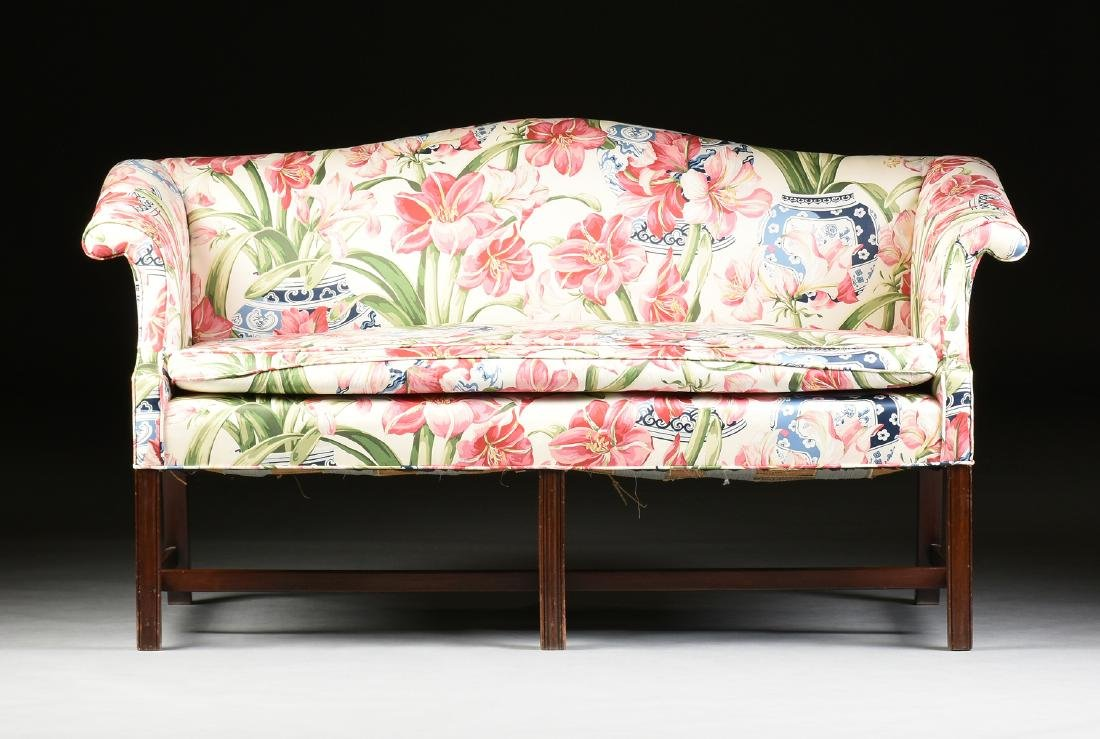 A CHIPPENDALE STYLE MAHOGANY CAMEL BACK SOFA, POSSIBLY