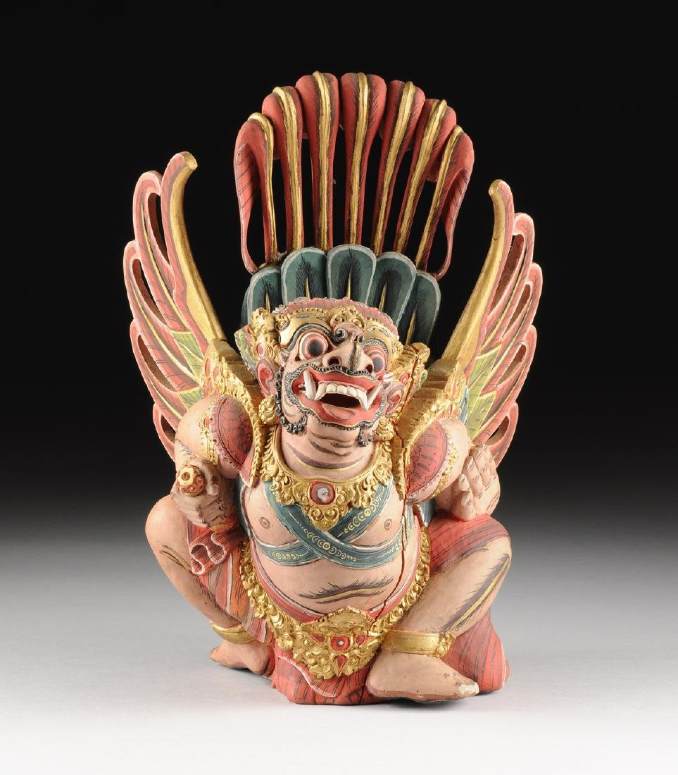 A BALI GILT AND POLYCHROME PAINTED WOOD FIGURE OF THE