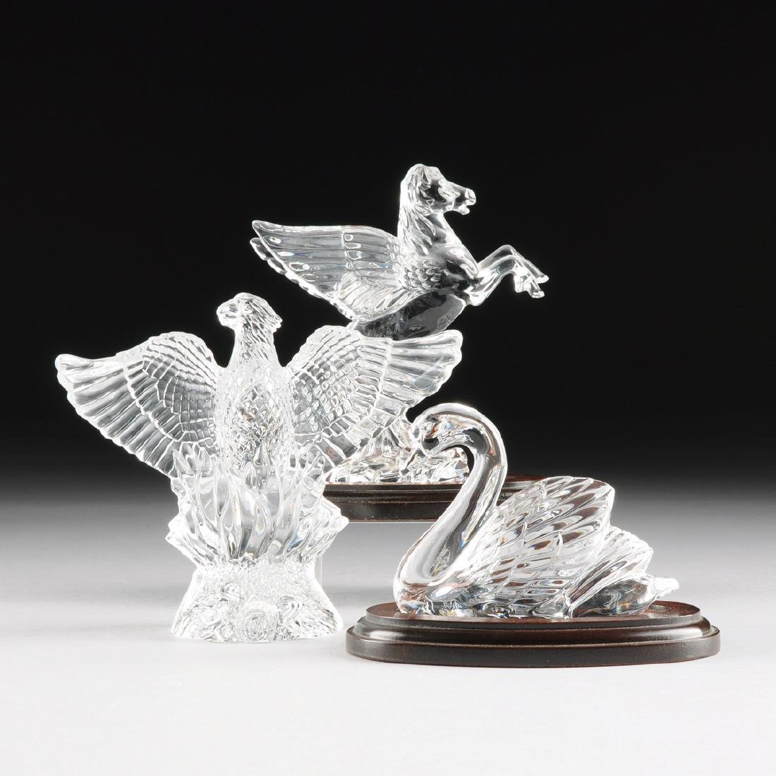 A GROUP OF THREE WATERFORD CRYSTAL FIGURES, FROM THE