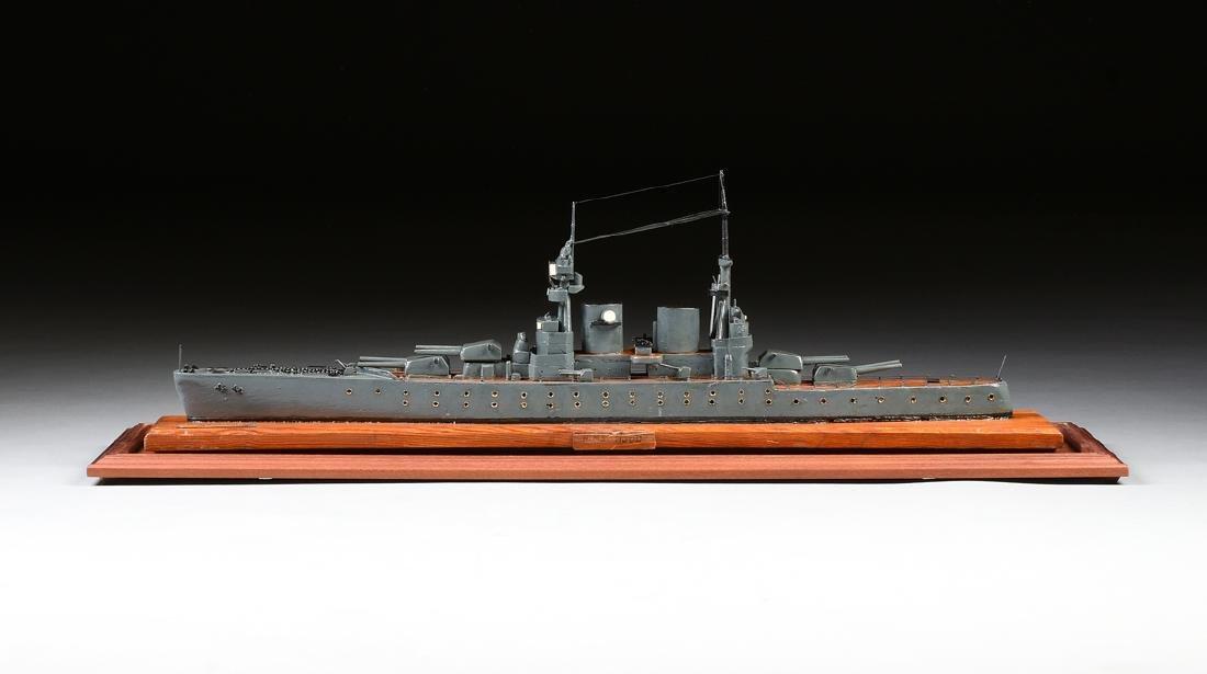 A WWII ERA HAND CARVED MODEL OF BRITISH BATTLESHIP HMS