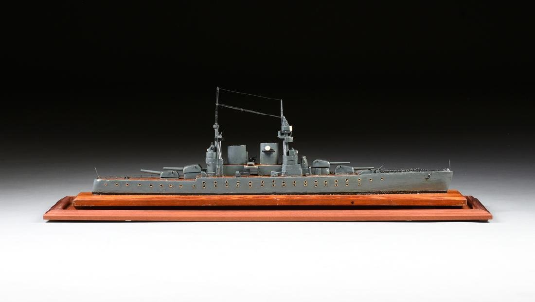 A WWII ERA HAND CARVED MODEL OF BRITISH BATTLESHIP HMS - 6