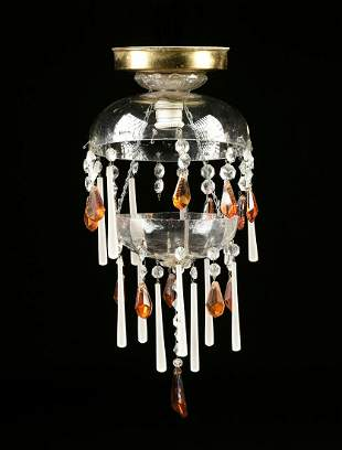 A VINTAGE CLEAR, AMBER AND MILK GLASS CHANDELIER, MID