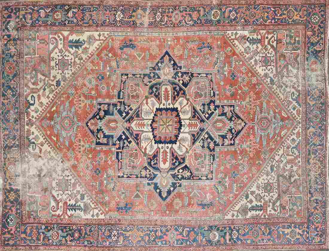 A SEMI ANTIQUE PERSIAN HERIZ CARPET, EARLY 20TH