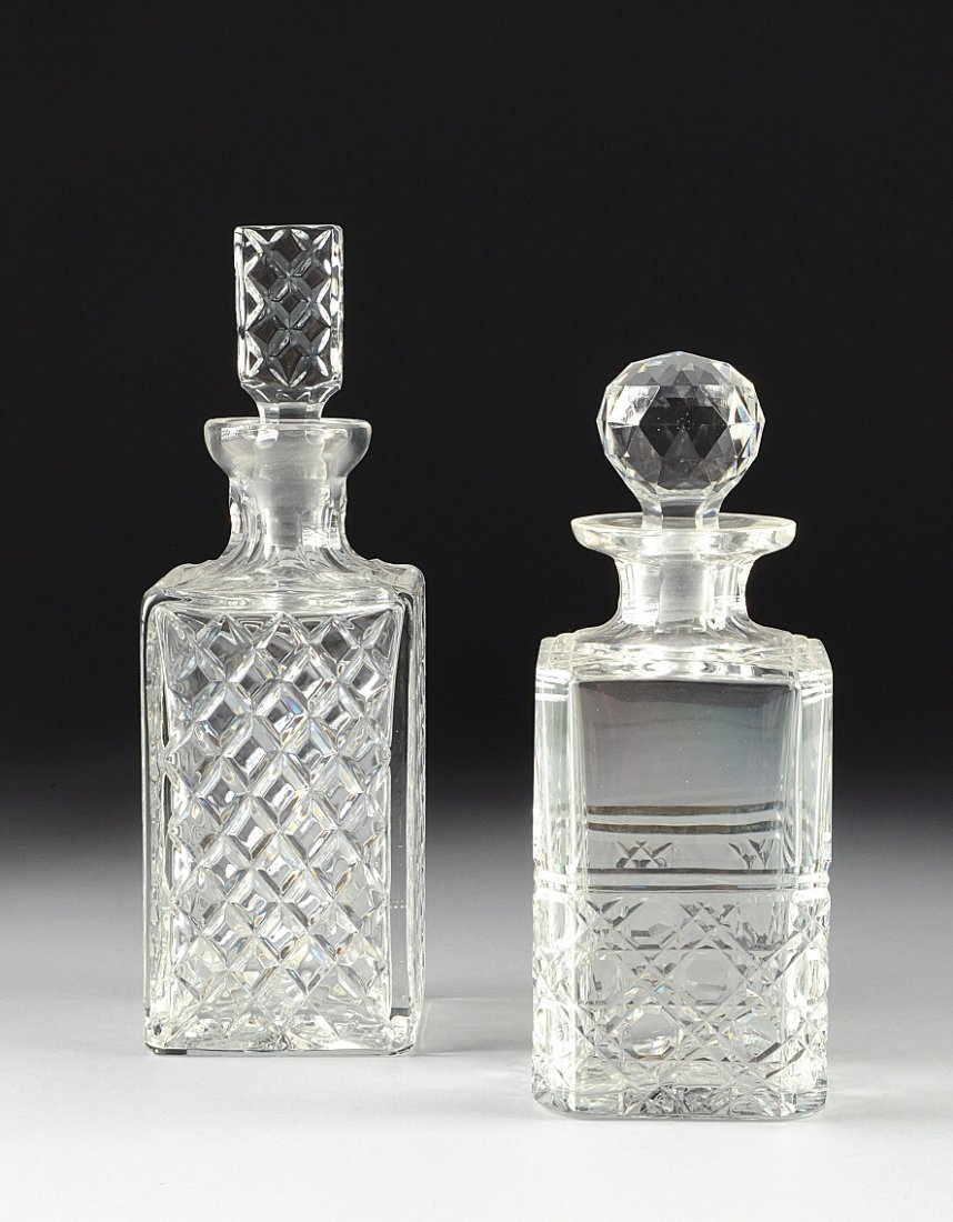 TWO CUT AND MOLDED CRYSTAL DECANTERS, POSSIBLY