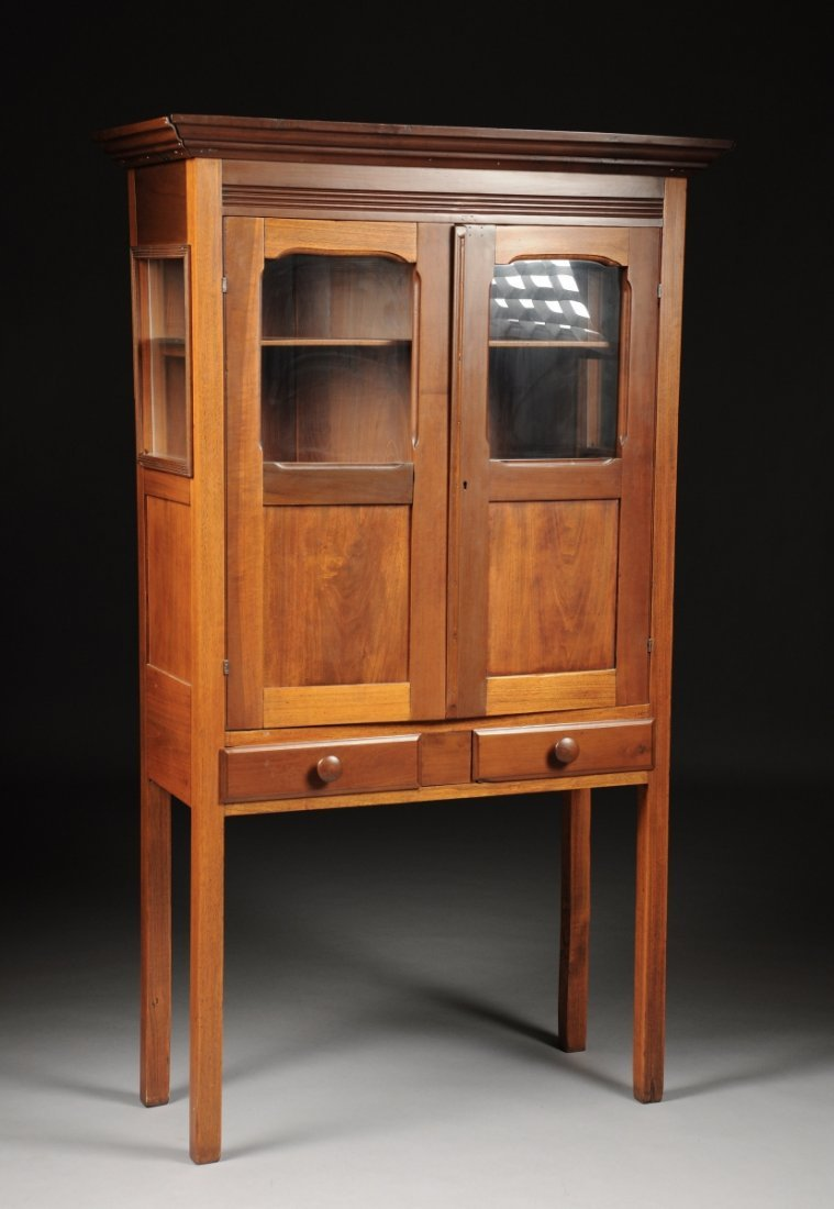 AN AMERICAN CARVED CHERRY CABINET, 19TH CENTURY,  the