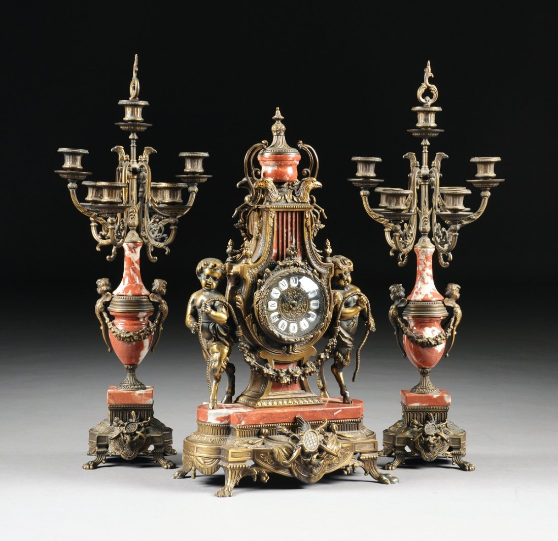 A LOUIS XVI STYLE LACQUERED GILT METAL AND ROUGE MARBLE