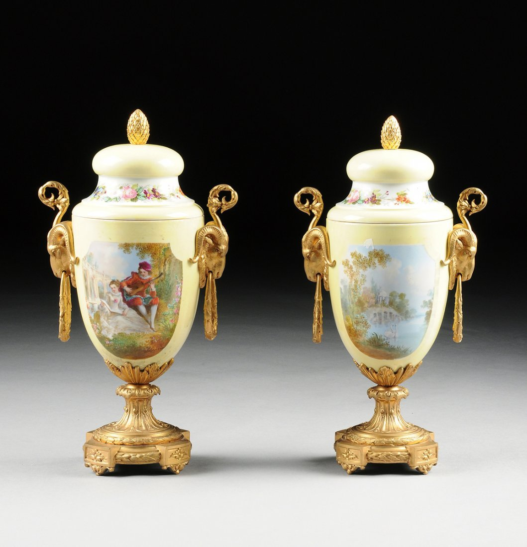 A PAIR OF FRENCH SÈVRES STYLE POLYCHROME PAINTED YELLOW