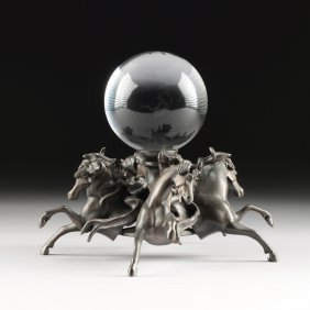 A Continental Spelter And Glass Orb Figural