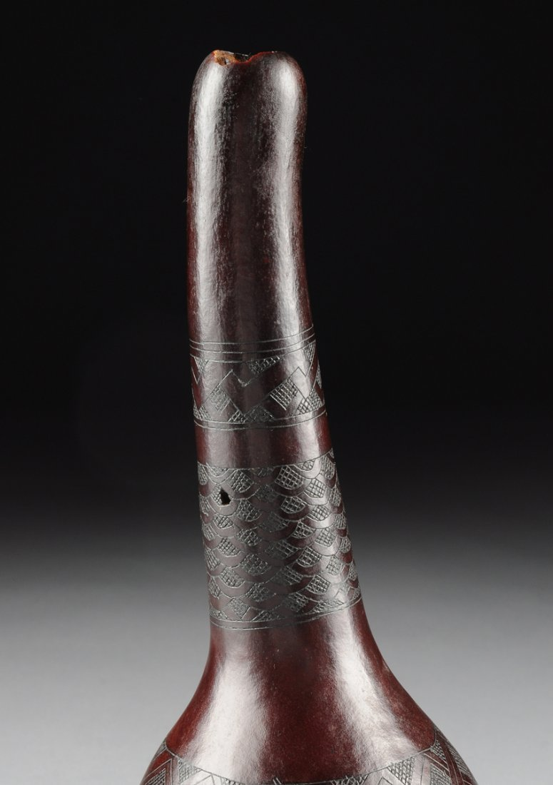 AN AFRICAN TRIBAL INCISED GOURD FORM MUSICAL INSTRUMENT - 9