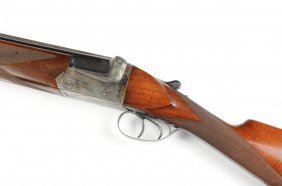 A 20 Guage Over And Under Shotgun, Engraved Gun Makers