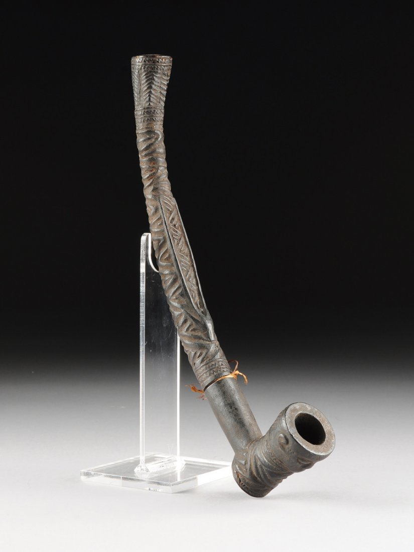AN AFRICAN TRIBAL BAKONGO CARVED ANTLER PIPE, THIRD