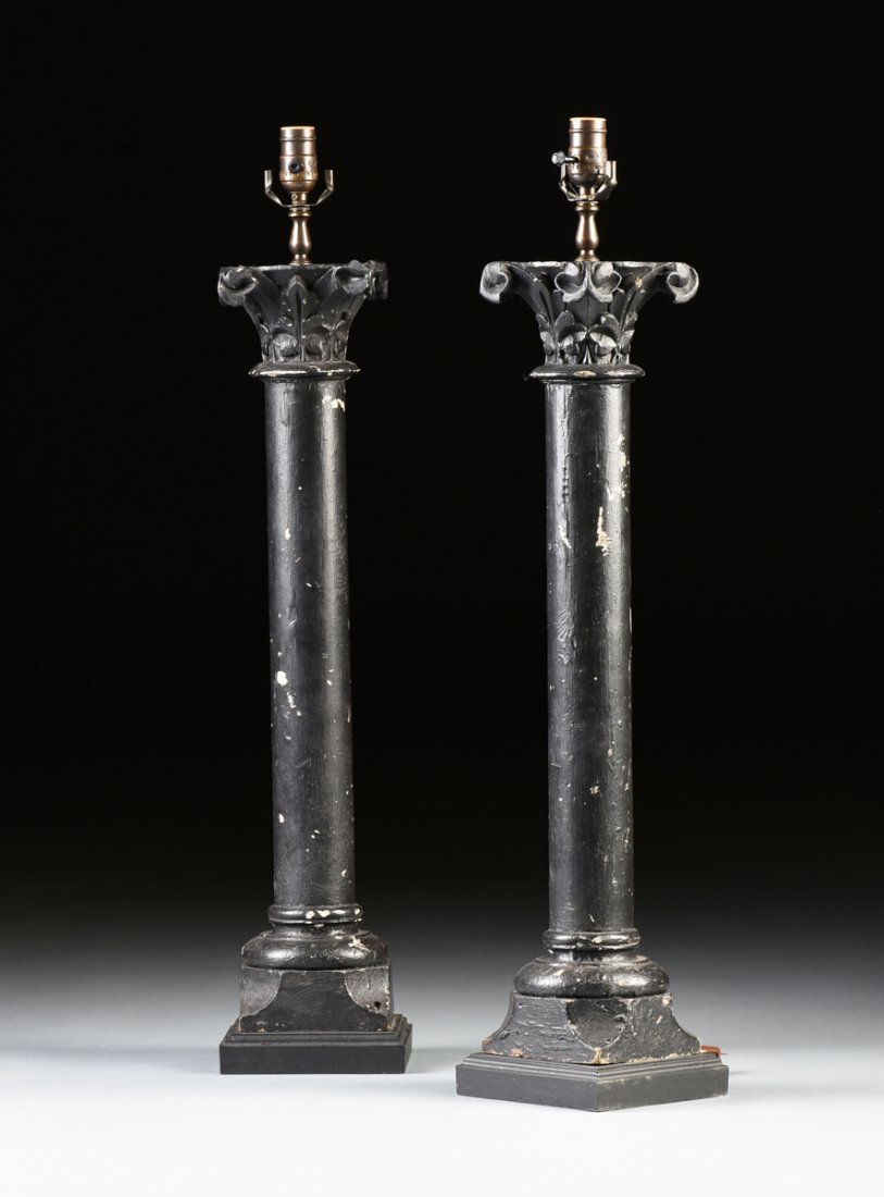 A PAIR OF ROMANESQUE REVIVAL BLACK PAINTED CARVED WOOD