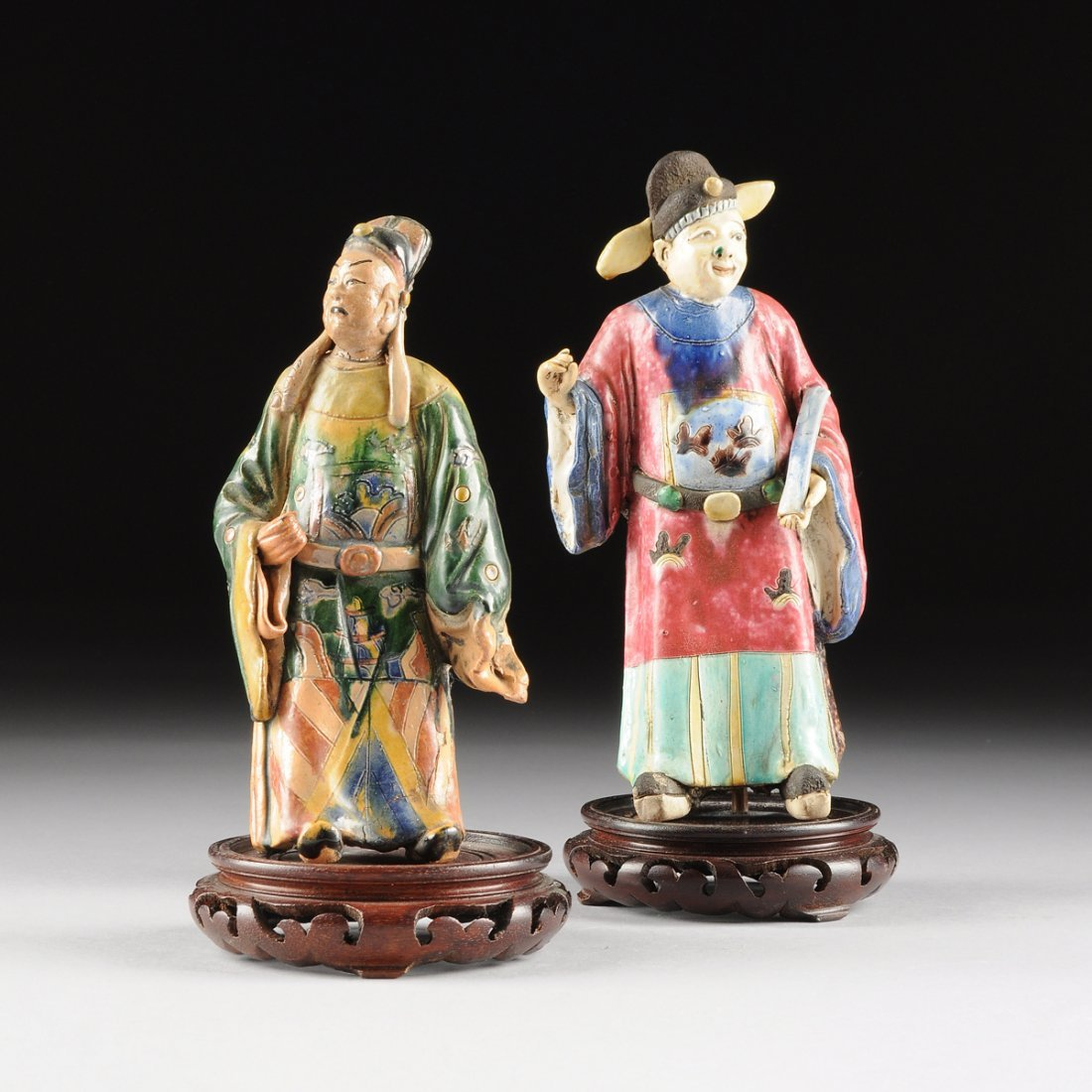 TWO CHINESE POLYCHROME GLAZED EARTHENWARE DEITIES,