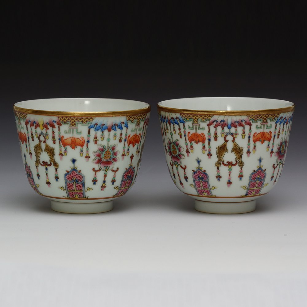 PAIR OF CHINESE FAMILLE ROSE QIANLONG MARK CUPS
