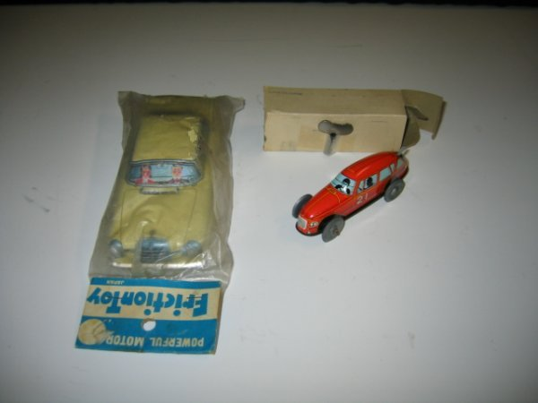 573: 2 JAPAN TIN FRICTION CARS IN PACKING